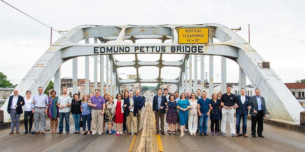Officials standing on the Edmund Pettus Bridge